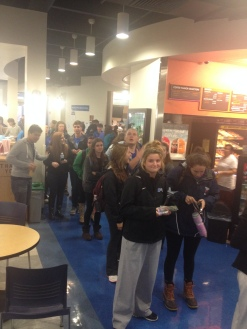 Students line up to purchase their tickets before they sell out.